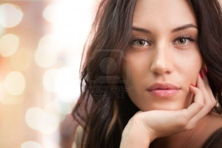 7338365-portrait-of-attractive-brunette-girl-with-bokeh-lights-on-background