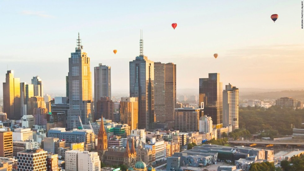 CWDPFH Hot air balloons aloft over Melbourne city at dawn, Victoria, Australia.